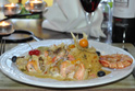 Monkfish & Salmon Kebabs Served with a Spicy Thai Coconut Sauce with Tiger Prawns